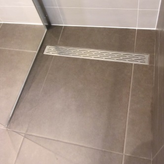 Wet room floors tanking drains screens free advice for Wet room shower tray for vinyl